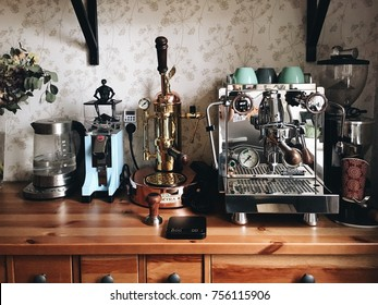 VORONEZH, RUSSIA-11.15.2017: Perfect home setup for making coffee: Rocket r58v2, Elektra espresso machines, Eureka mignon blue grinder, K2SO from Star wars and Rondell tea kettle, wood table
