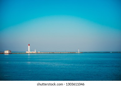Vorontsov Lighthouse in the gulf of Odessa, Ukraine. Beautiful sunny day landscape with sea skyline. Amazing city panorama with blue water and beacon, pharos, seamark.