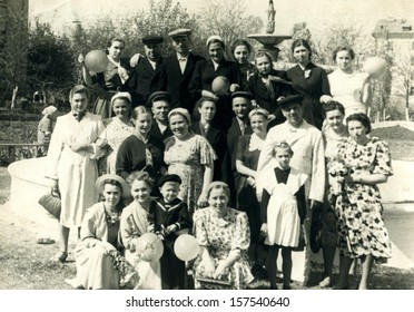 VOROSHILOVGRAD - CIRCA 1950s: Families of staff of Regional Cancer Center posing in the yard of a cancer center, Voroshilovgrad, now Lugansk, Ukraine, USSR, 1950s