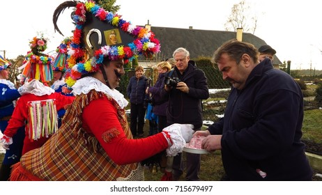 VORTOVA, CZECH REPUBLIC – FEBRUARY 25, 2017: A man serves free shots of liquor at Masopust, a UNESCO-listed Pre-Lenten Shrovetide carnival celebration in the Czech Republic.