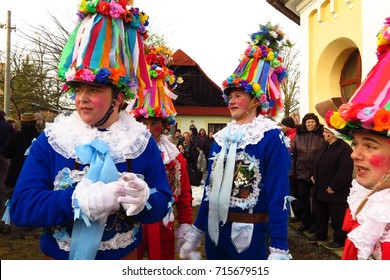 VORTOVA, CZECH REPUBLIC – FEBRUARY 25, 2017: Men dress in colorful suits and hats to celebrate Masopust. The Pre-Lenten Shrovetide carnival procession is the Czech version of Mardi Gras.