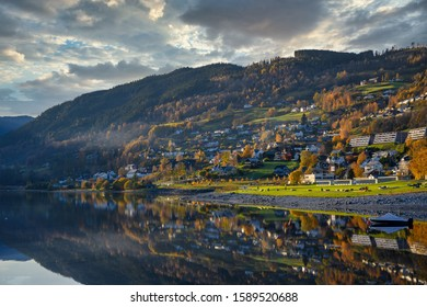Voss city in Norway, a mountain view in autumn, changes the color of the leaves to change to yellow and orange reflections in the water. Is a beautiful natural scenery of Norway.