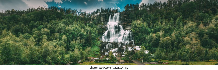 Voss, Hordaland, Norway. Waterfall Tvindefossen In Spring. Largest And Highest Waterfall Of Norway. Famous Natural Norwegian Landmark And Popular Destination. Panorama, Panoramic View.