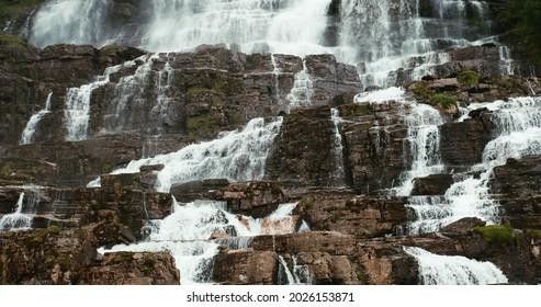 Voss, Hordaland, Norway. Waterfall Tvindefossen In Spring. Waterfall Tvindefossen Is Largest And Highest Waterfall Of Norway. Famous Natural Norwegian Landmark And Popular Destination.