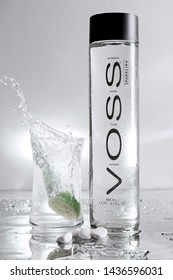 voss water bottle with a splash made with a lemon