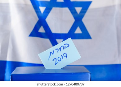 Vote box. Hebrew text Elections 2019 on voting paper over Israel flag background. Israeli legislative Elections for the 21st Knesset Israel 9 April 2019.