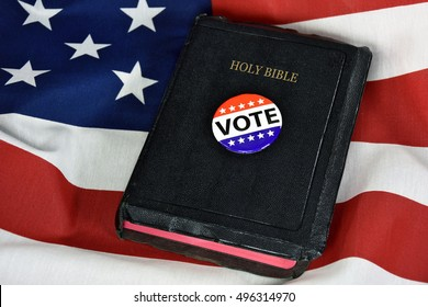 vote button and Bible on American flag