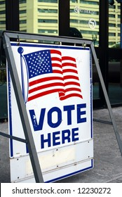Vote here sign in downtown