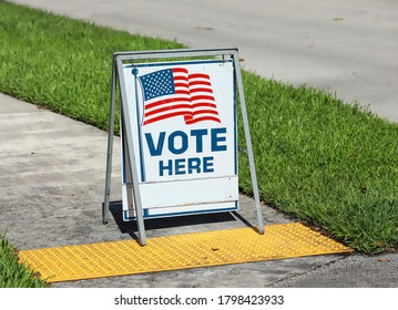 Vote Here Sign placed on the walkway to a neighborhood polling place, as seen on election day in Fort Lauderdale, Florida, USA