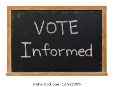 Vote informed written in white chalk on a black chalkboard isolated on white