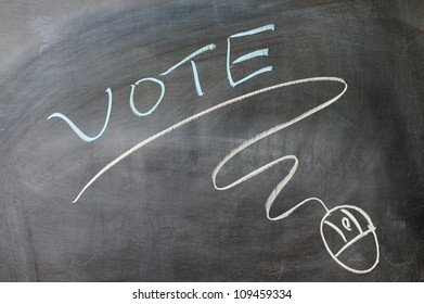 Vote and mouse symbol drawn on the blackboard