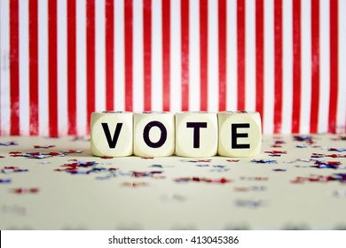 """""""VOTE"""" printed on white dice with striped background and confetti lens effect"""
