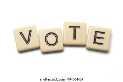 Vote spelled out with lettered tiles on white background. Clipping path included.