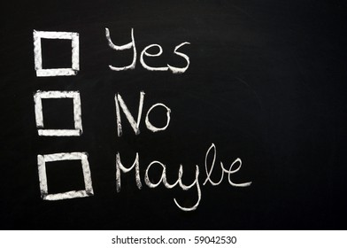 vote yes or no written on chalkboard or blackboard