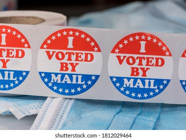 I Voted by Mail sticker on protective face mask for absentee ballot or mail-in voting in the presidential election during coronavirus pandemic