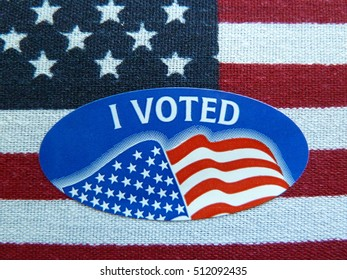 I voted sticker on American Flag with blur abstract background, selective focus.