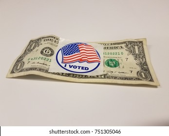 an I voted sticker on a dollar bill