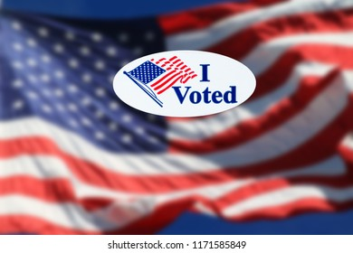 I Voted sticker on the US flag back ground.