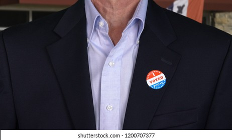 I Voted Today sticker on the shirt of a formally dressed senior caucasian man for midterm elections in the USA