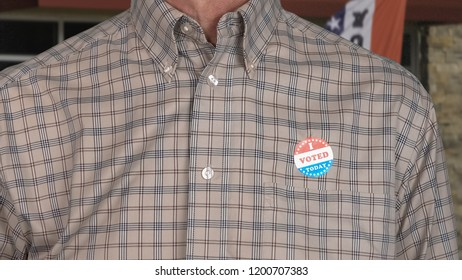I Voted Today sticker on the shirt of a casually dressed senior caucasian man for midterm elections in the USA