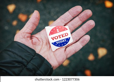 I voted today sticker in a persons hand after voting
