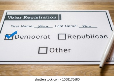 Voter registration card with Democratic party selected - Close Up. A close up photo of a faux voter registration form signifying that a person is joining the democratic party.