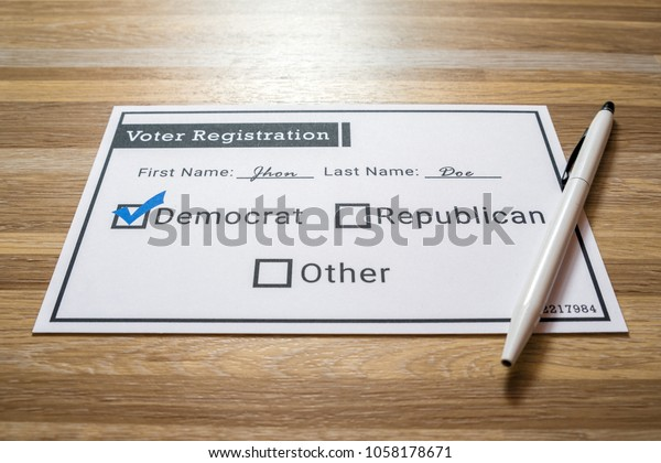 Voter registration card with Democratic party selected. A photo of a faux voter registration form signifying that a person is joining the democratic party.