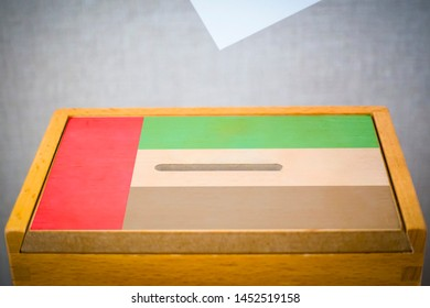 A voting box with the flag of United Arab Emirates and white voting paper