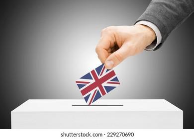 Voting concept - Male inserting flag into ballot box - United Kingdom