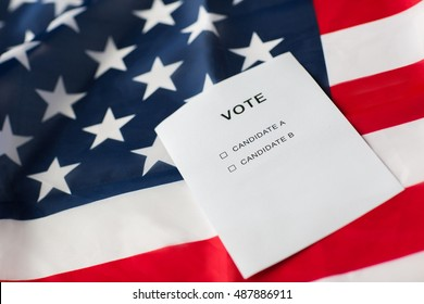 voting, election and civil rights concept - empty ballot or vote with two candidates on american flag