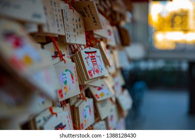 Votive tablets at Japanese traditional shrine. Shinjuku district Tokyo Japan - 01.10.2019 : It s a votive tablet called EMA at the traditional shrine. Translation on votive tablet text Passing .
