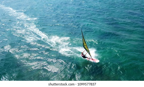 Vouliagmeni, Athens / Greece - May 27 2018: Aerial drone bird's eye view photo of competition surf race in wavy clear waters of Athenian riviera, Attica