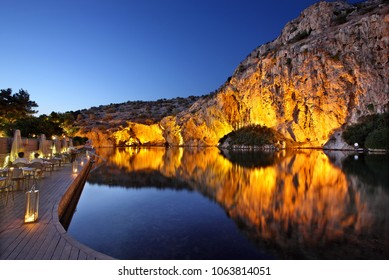 VOULIAGMENI LAKE, ATTICA, GREECE - August 30, 2015. Night view of Vouliagmeni lake, ideal place for relaxation and wellness treatment.