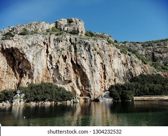 Vouliagmeni, Thermal Radonic Mineral Water Lake near Athens, Greece. Just outside of Athens lies the geophysical rarity known as Lake Vouliagmeni.