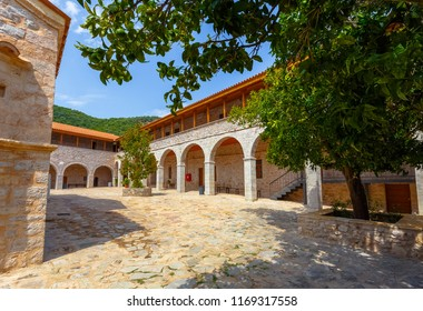 Voulkanos Monastery building details on Voulkanos mountain against a cloudy sky