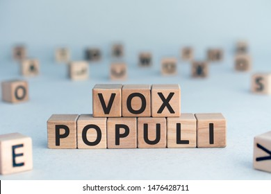 vox populi - Latin words from wooden blocks with letters, opinions of people vox pop voice of the people concept, random letters around, white  background