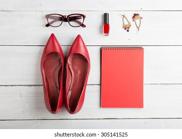 Voyage concept - set of woman stuff on wooden background