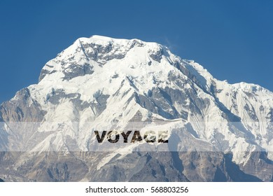 VOYAGE word over the background of the mountain. Concept for self belief, challenge, positive attitude and motivation quotes for Travel and Adventure.