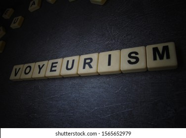 voyeurism, word cube with background.