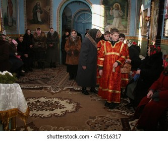 VOYUTYN, UKRAINE - 08 January 2009: Little sextons pick donation during holiday prayers
