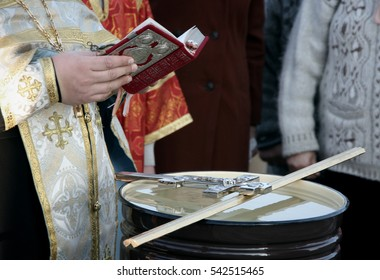 VOYUTYN, UKRAINE - 14 OCTOBER 2008: Orthodox priest blessing of water during the religious celebration Pokrov