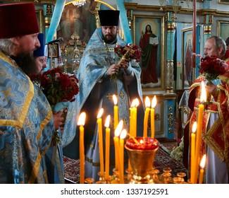 Voyutyn, Volyn / Ukraine - 14 October 2009: Orthodox priests during holiday prayers in local church