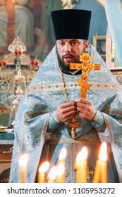 VOYUTYN, Volyn / UKRAINE - October 14 2009: Orthodox priest during holiday prayers in local church