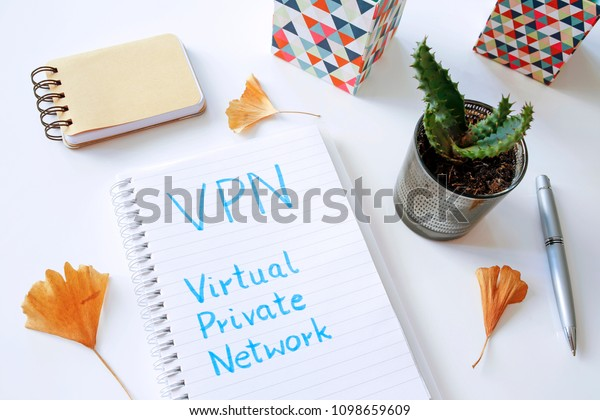 VPN Virtual Private Network written in notebook on white table