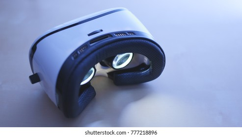 VR device playing video inside at night