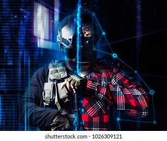 Vr gamer soldier. Swat soldier standing with automatic rifle with a vr player in helmet on neon futuristic background.