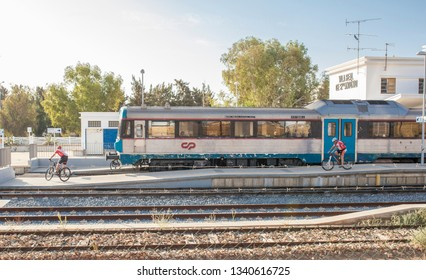 VR Sto Antonio, Portugal - Sept 30th, 2017: Mountain bikers getting down from train at railway station, Algarve, Portugal