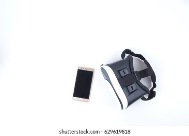 VR virtual reality glasses and Smartphone on white background top view and copy space. Start new experience for you. Working in a new way in everyday.