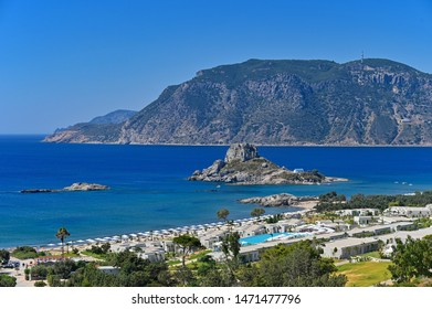 Vrachonisida Kastri - Greece island Kos. Beautiful concept for summer vacation and holiday. Landscape with sea, island and traditional small greek chapel. Natural colorful background.