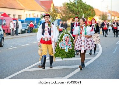 VRACOV - OCTOBER 15: Starek and Starka hold bell and walk in parade on The biggest folk feast in Czech Republic, Oct 15, 2011 in Vracov, Czech Republic. Feast Vracov